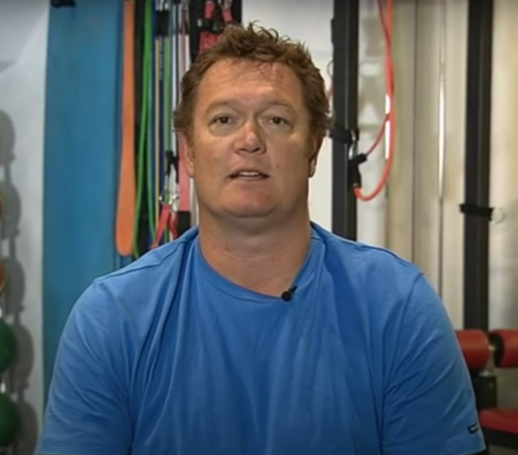 Image of Luc Longley being interviewed in 2014